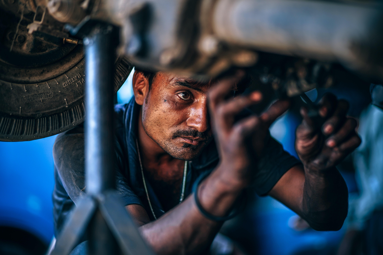 man repairing vehicle