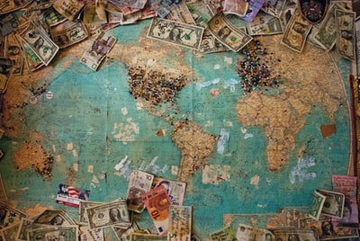 u.s. dollar banknote with map world teams background