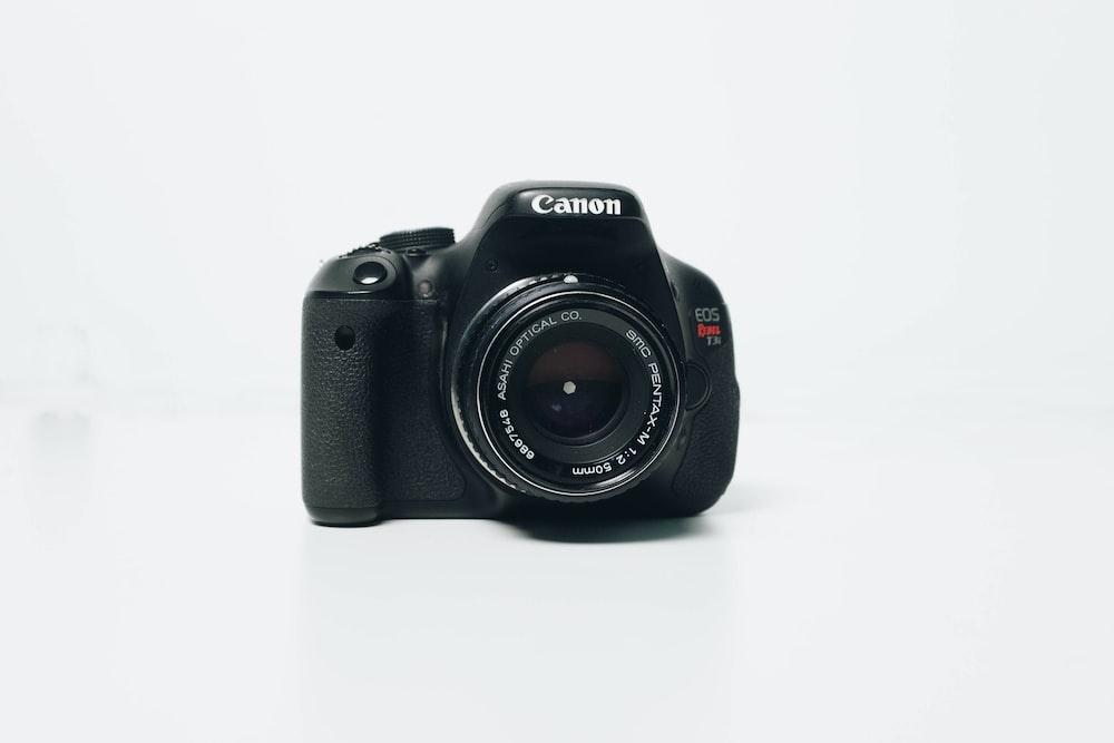 black Canon EOS Rebel-series DSLR camera