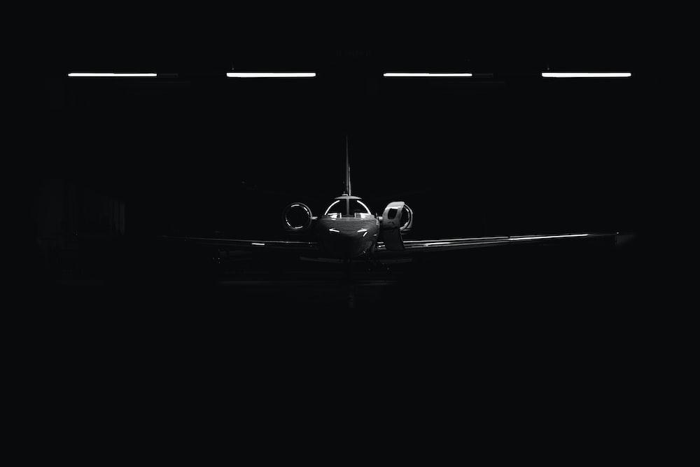 white jet plane in warehouse