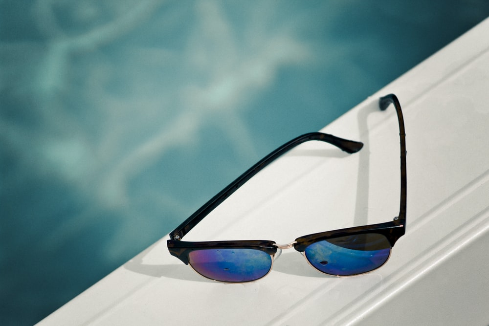 clubmaster sunglasses on white surface