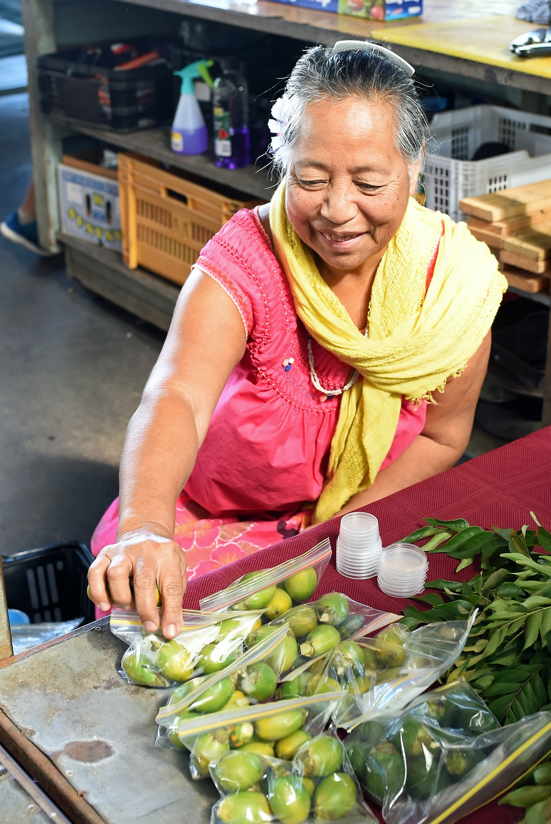This friendly lady was selling Betel nuts at Rusty's markets in Cairns, Australia. I liked the lighting (through a skylight) and the colours of her clothes, and something of her personality shines through in the photo. Betel nuts are popular for chewing in New Guinea and many Pacific islands, but aren't actually good for you.