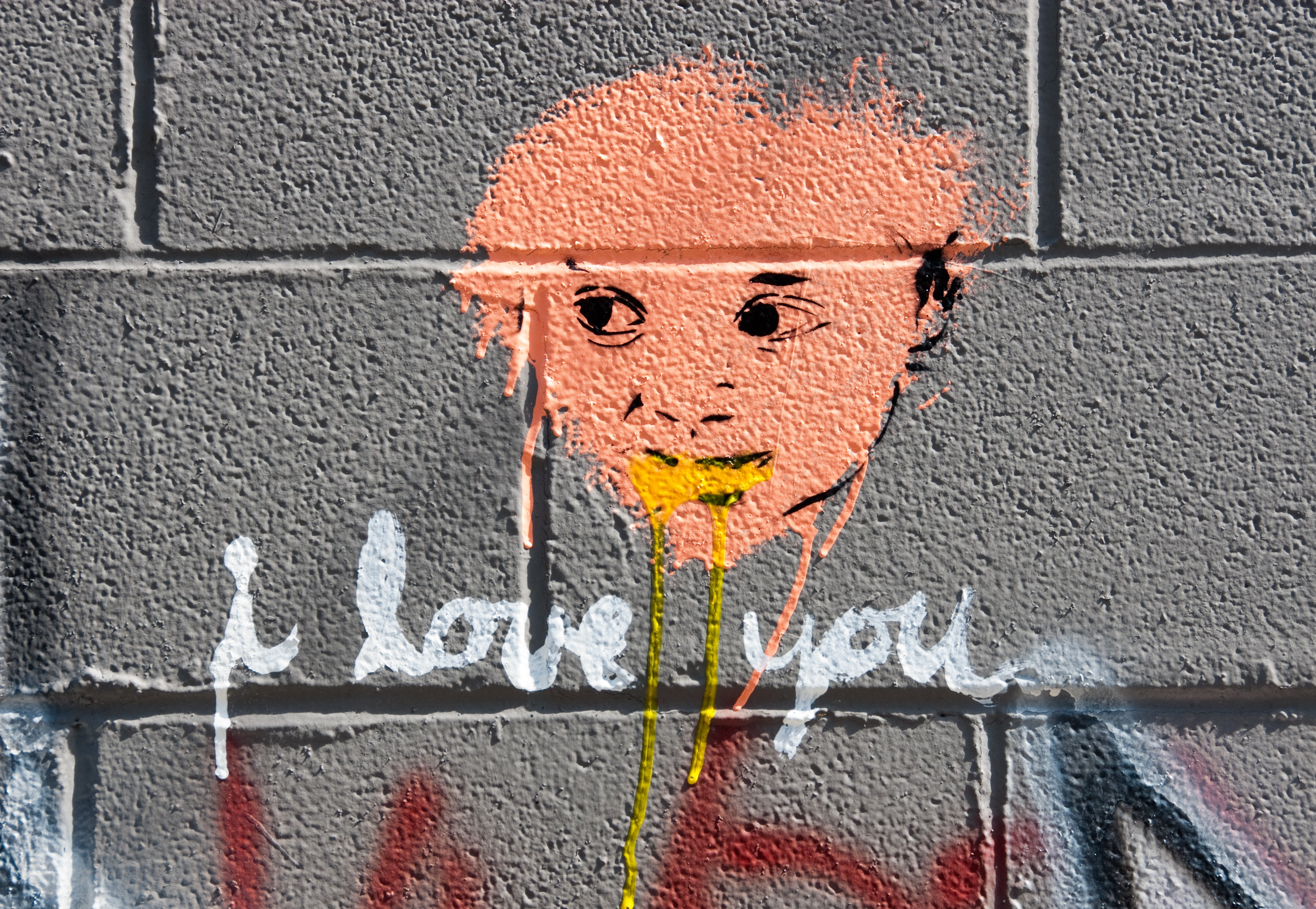 "Graffiti wall art in Kansas City with a face that says ""i love you"""