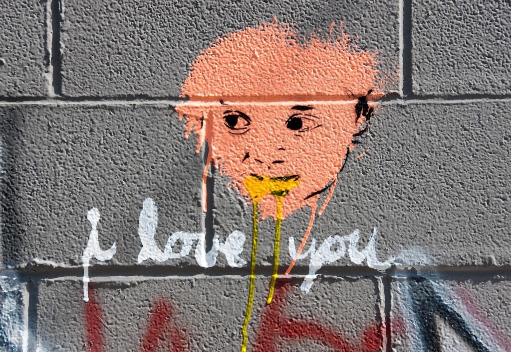 I Love You sign under face of man artwork