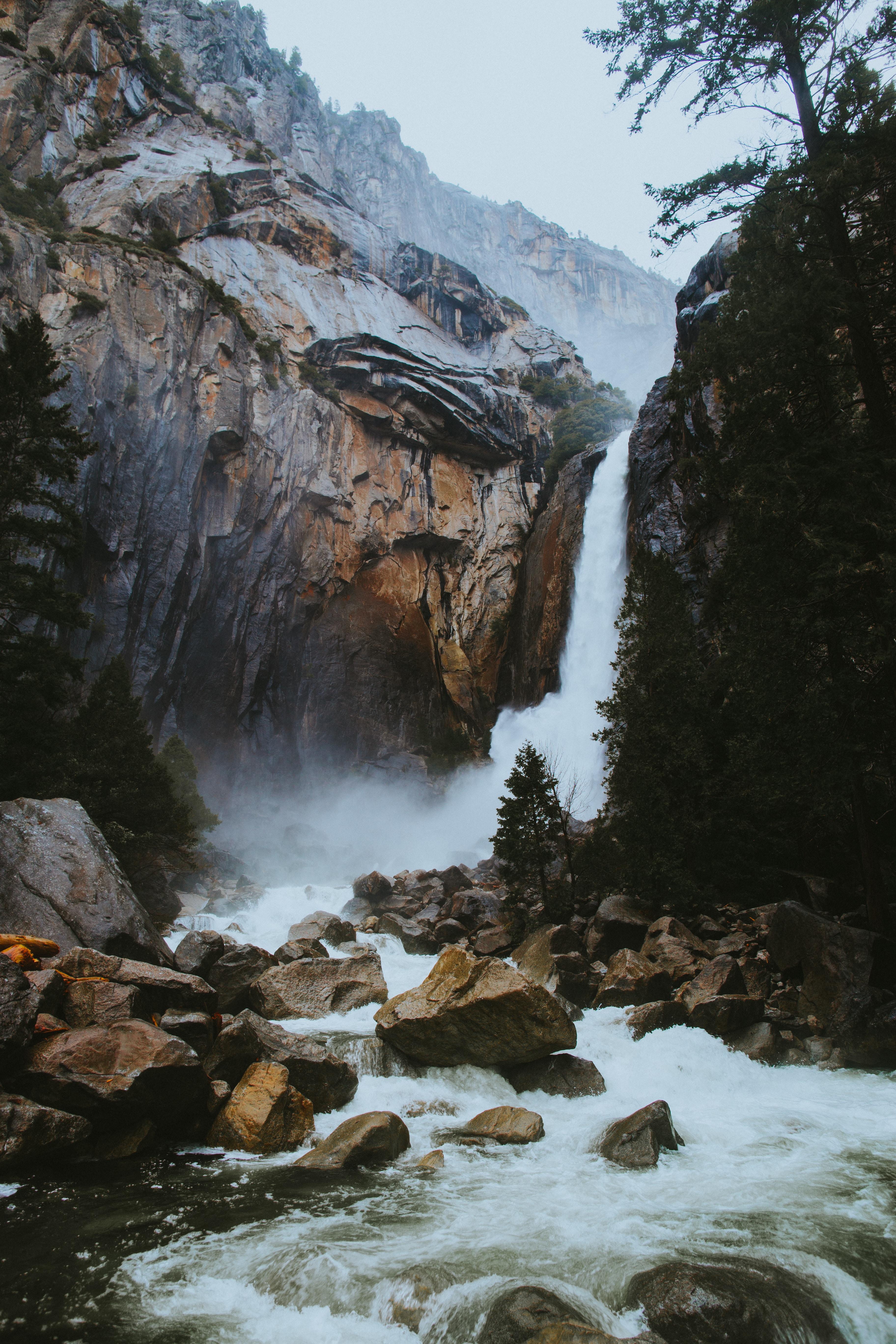 river stream between rocks during daytime
