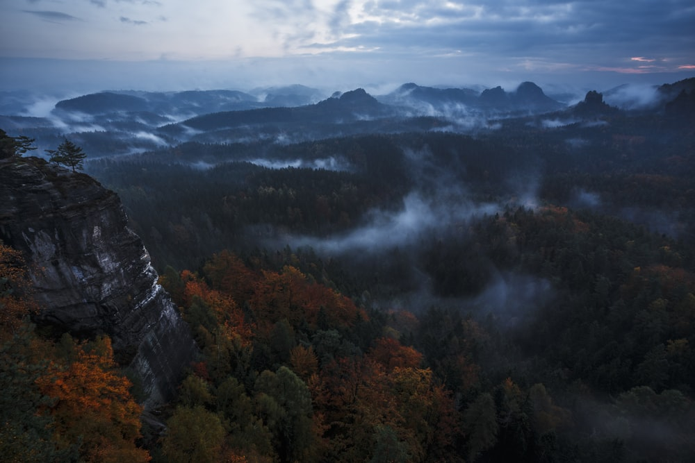 gray mountains under gray sky