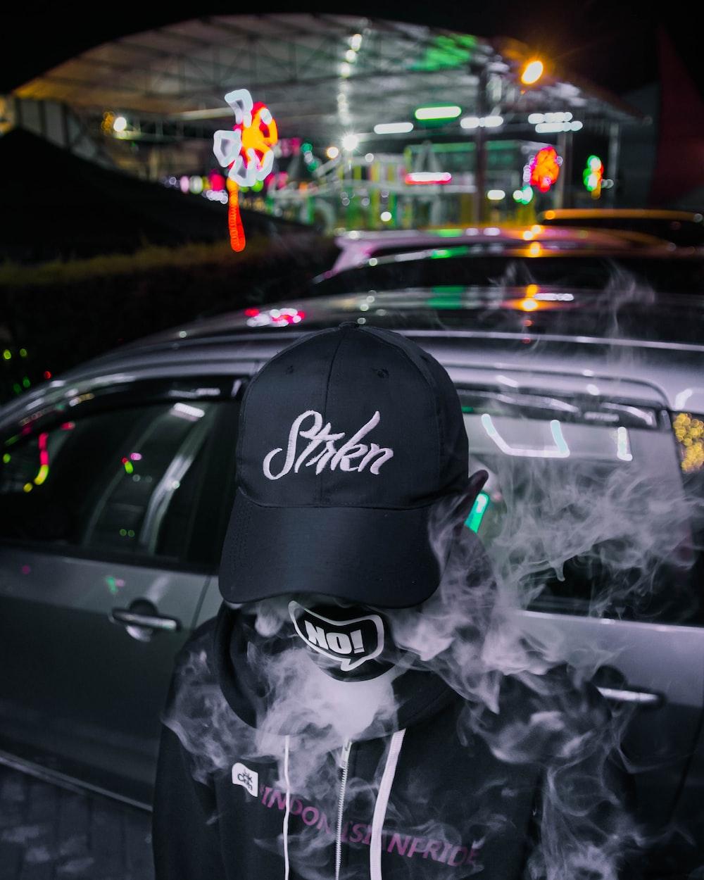 person smoking through mask