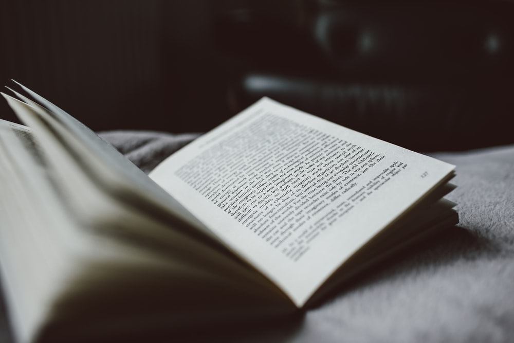 selective focus photography of opened textbook