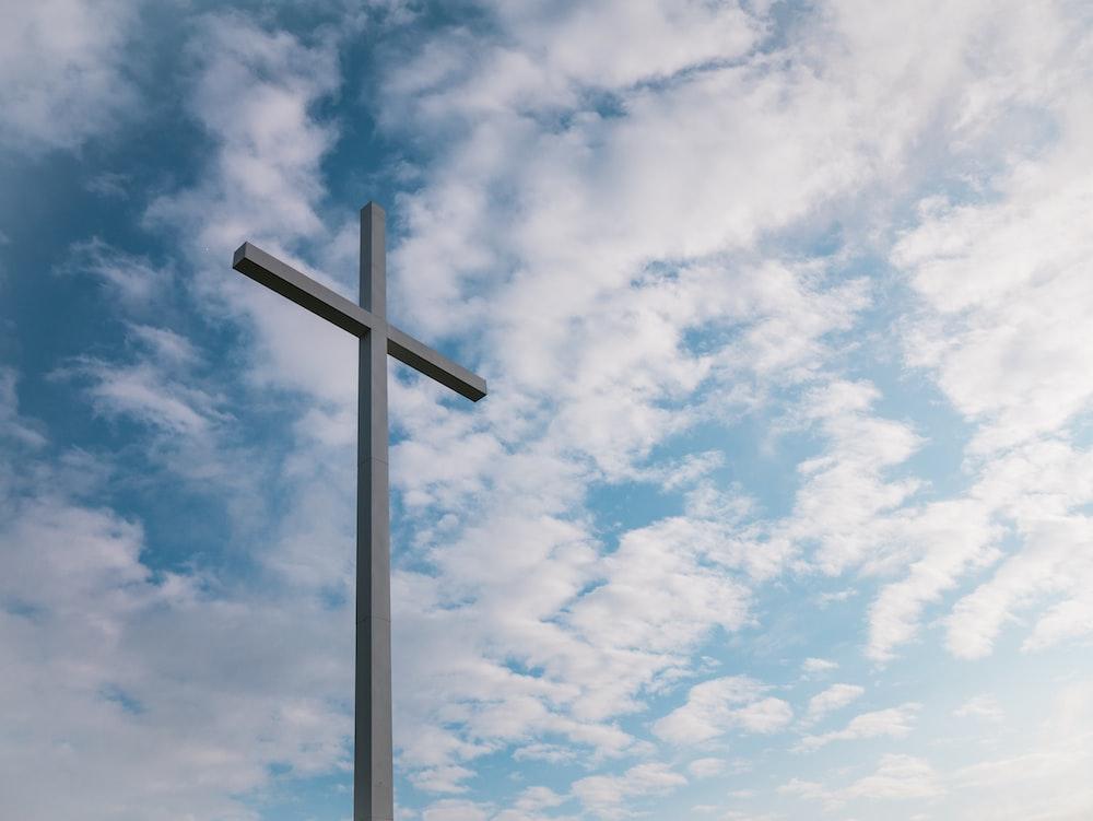 landscape shot of white cross during daytime