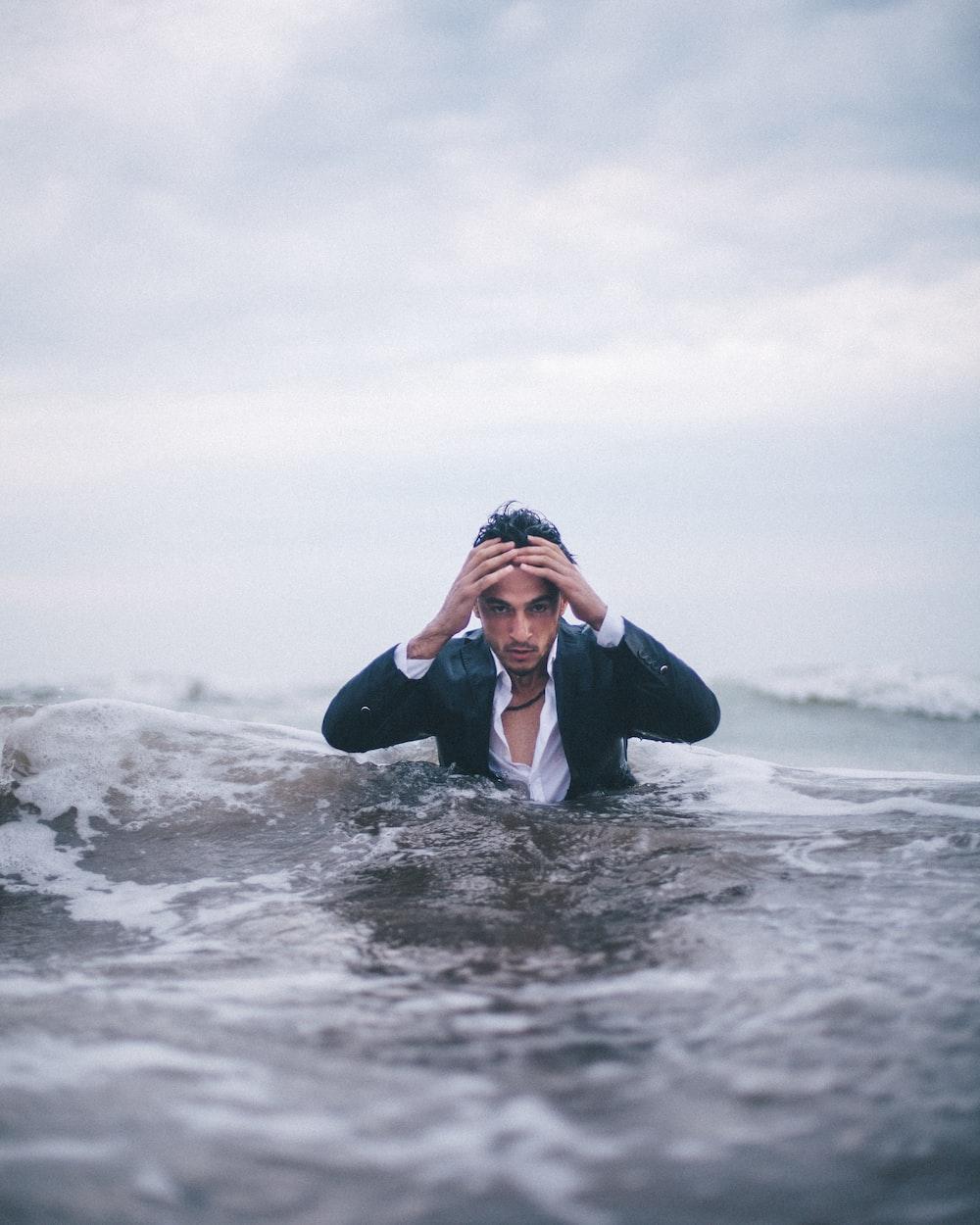 man on body of water during daytime