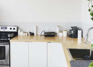 black coffee maker on brown wooden kitchen table