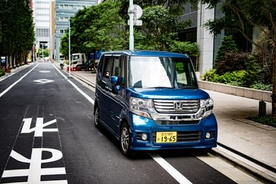 blue honda minivan during daytime honda teams background