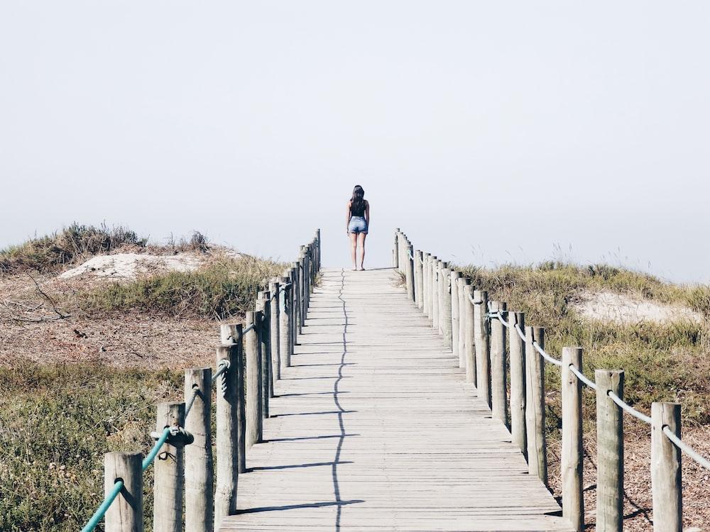 woman standing on the edge of the bridge