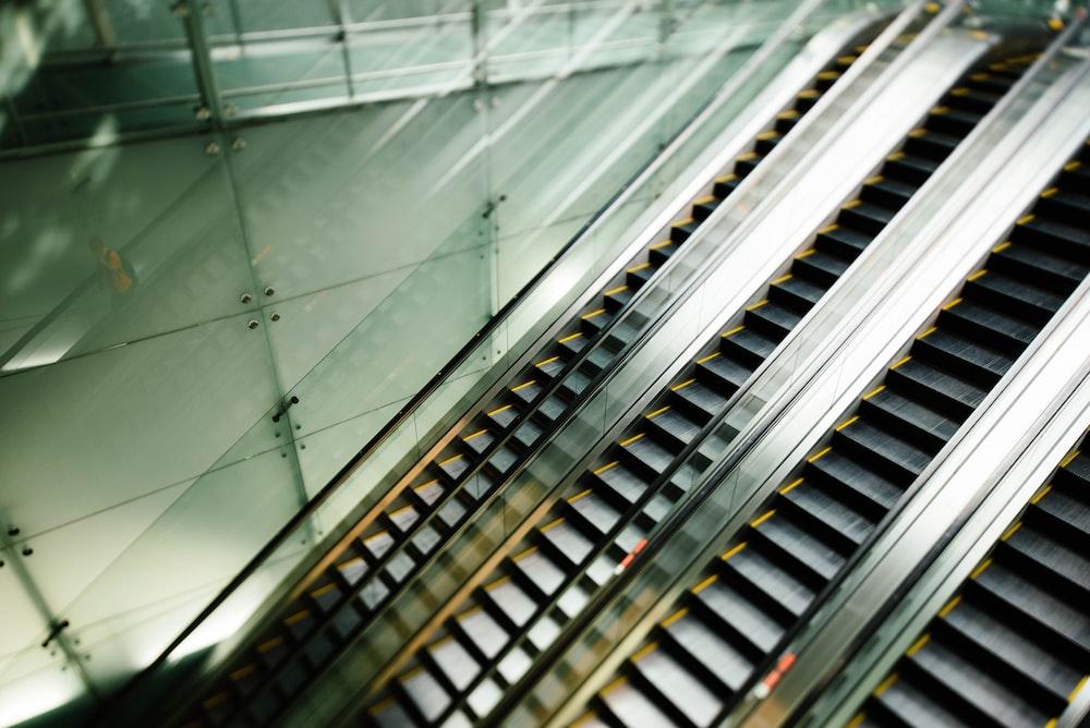 four black escalators