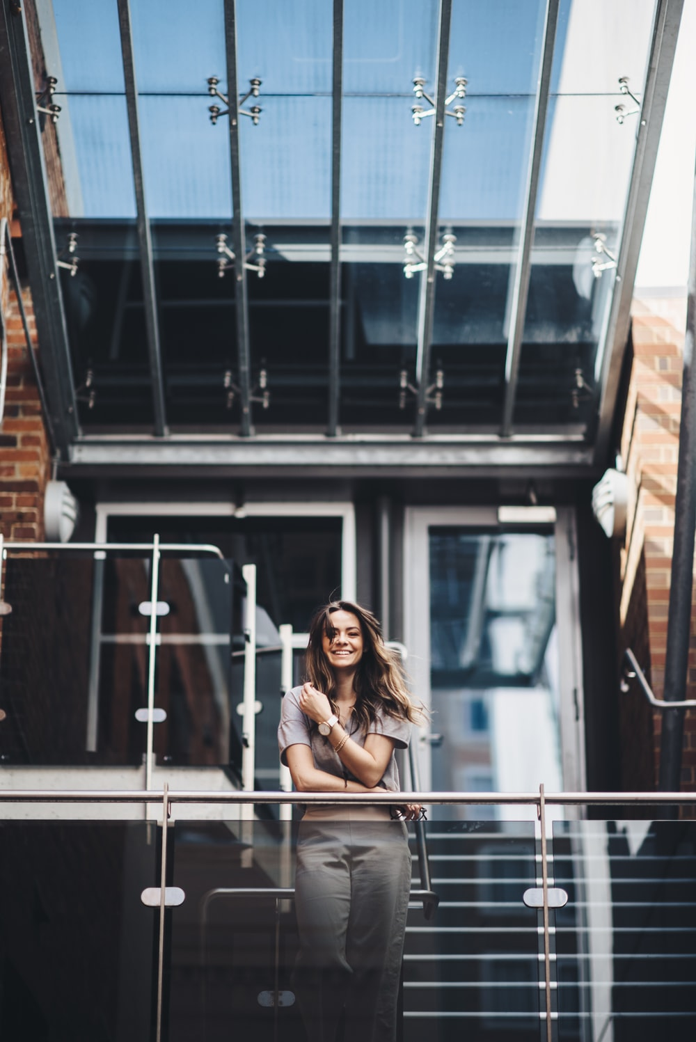 woman standing beside terrace