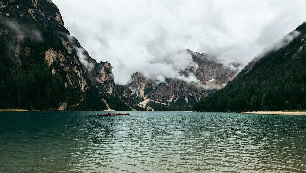 mountain in between body of water