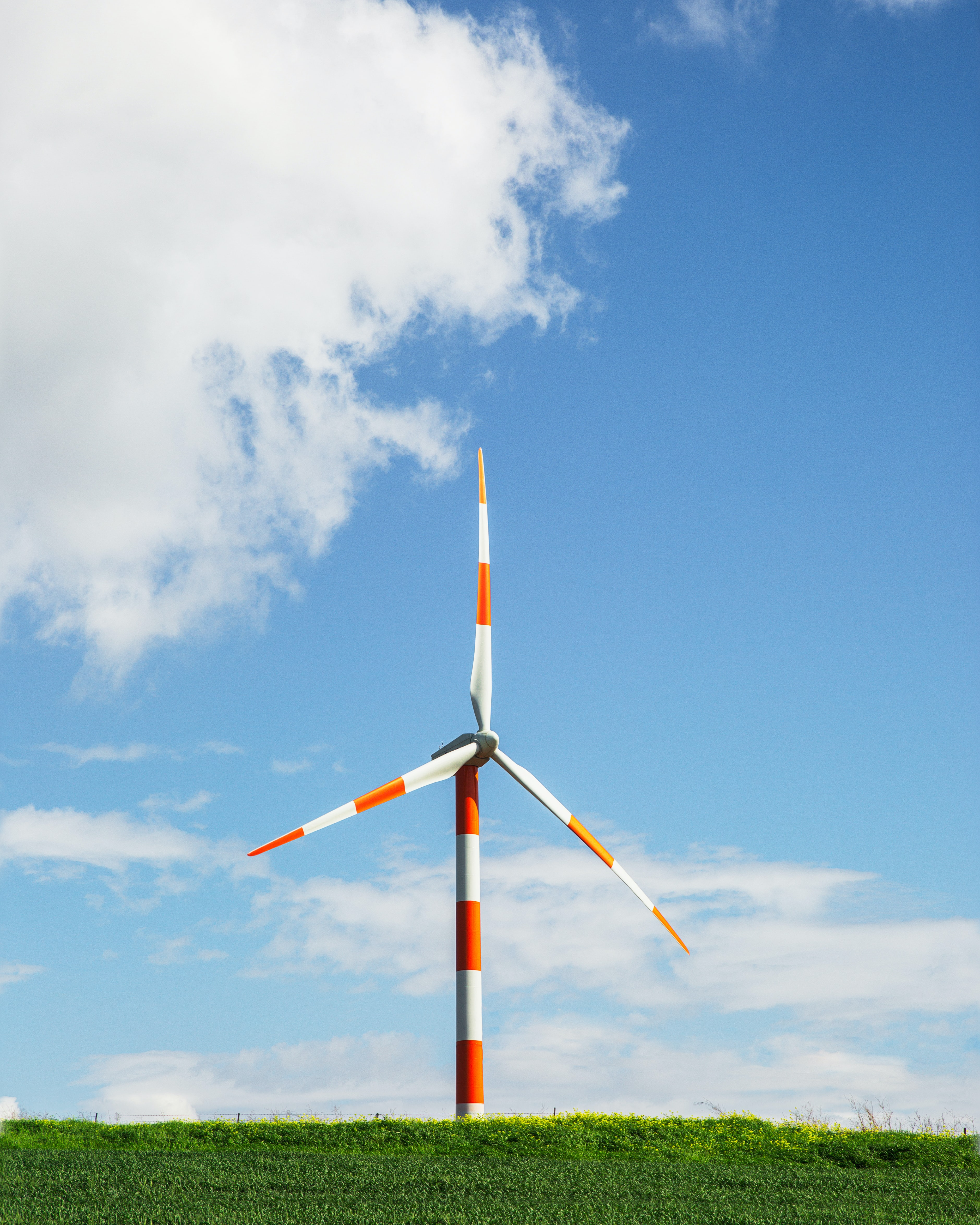 white and orange industrial wind mill