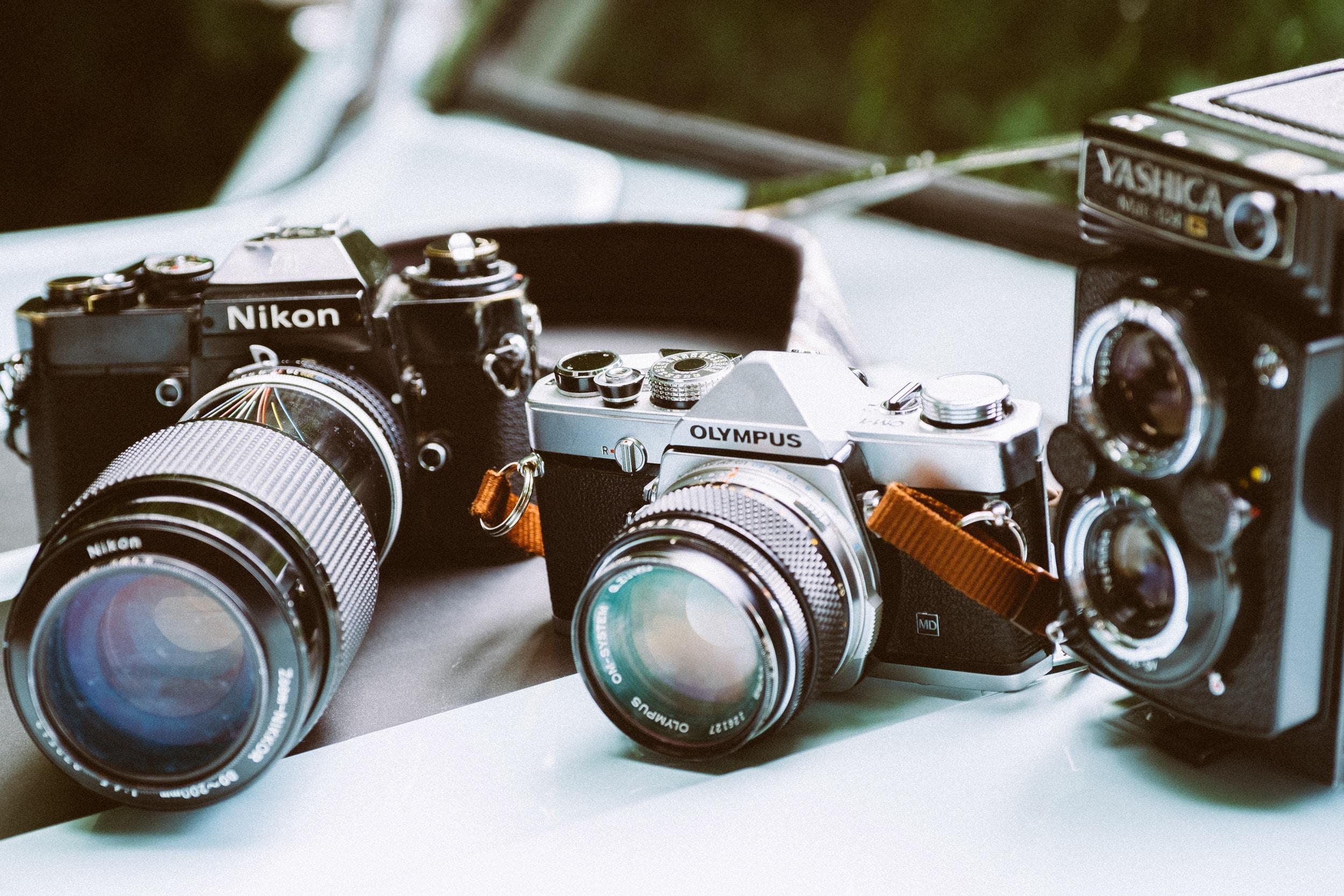 shallow focus photo of gray Olympus camera