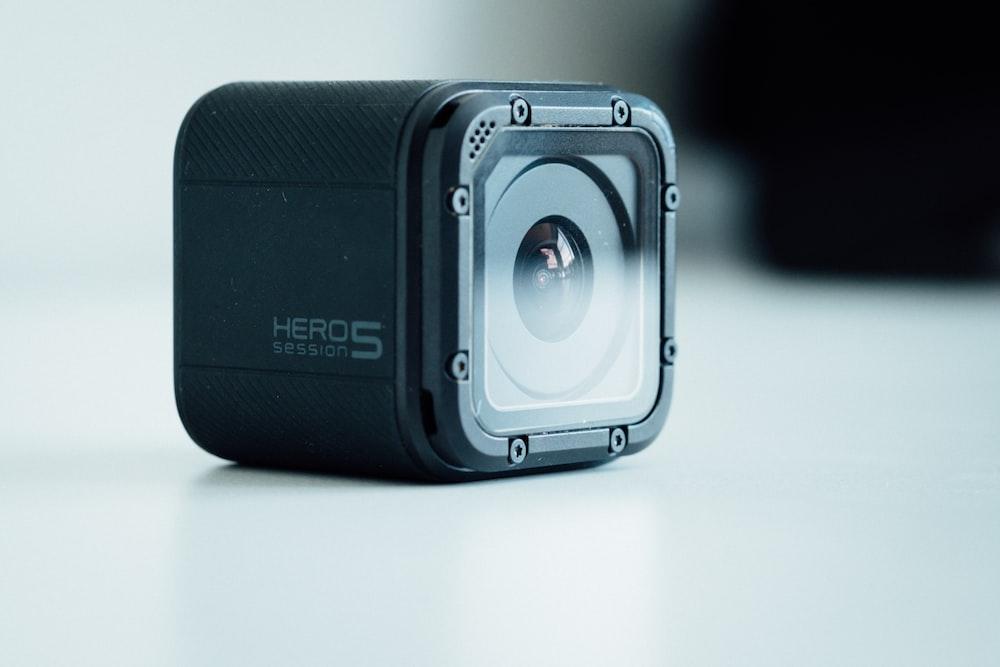 black GoPro HERO5 on white surface