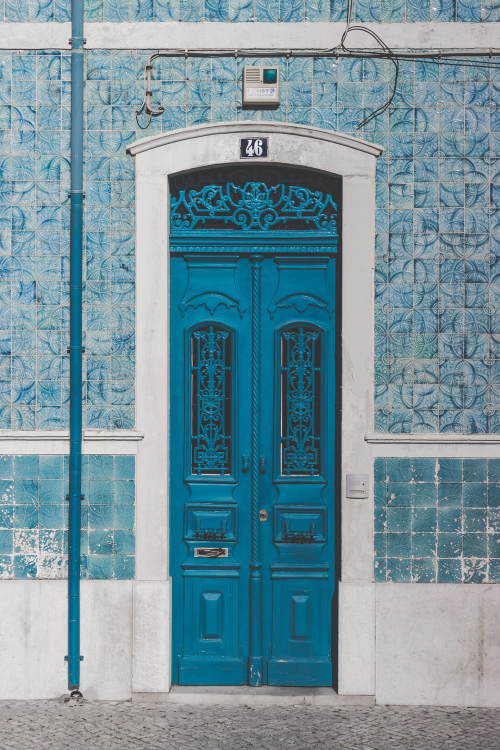 blue wooden door closed with 46 sign