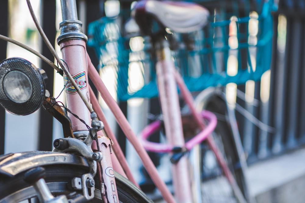 brown bike beside black fence