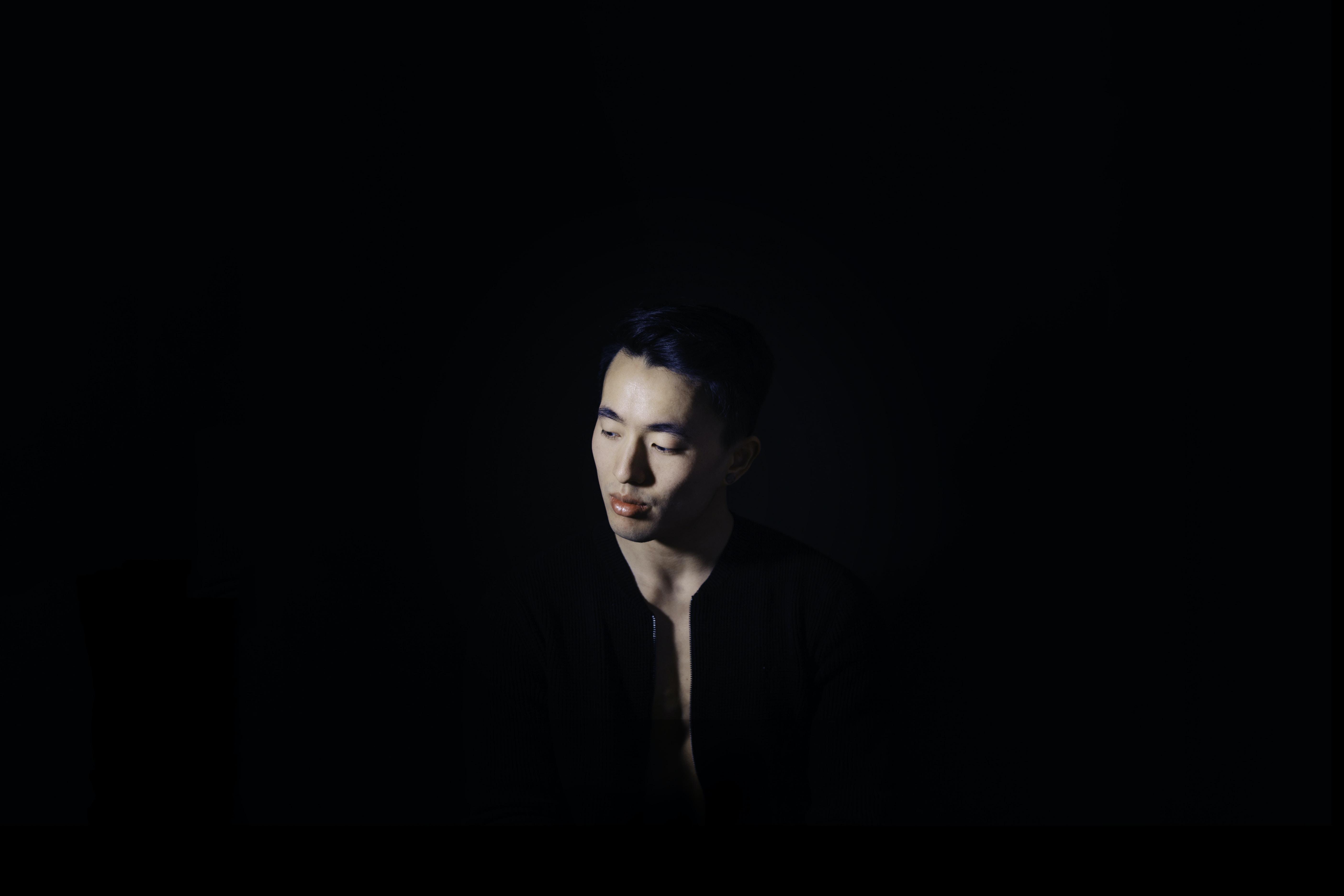 man standing wearing black top