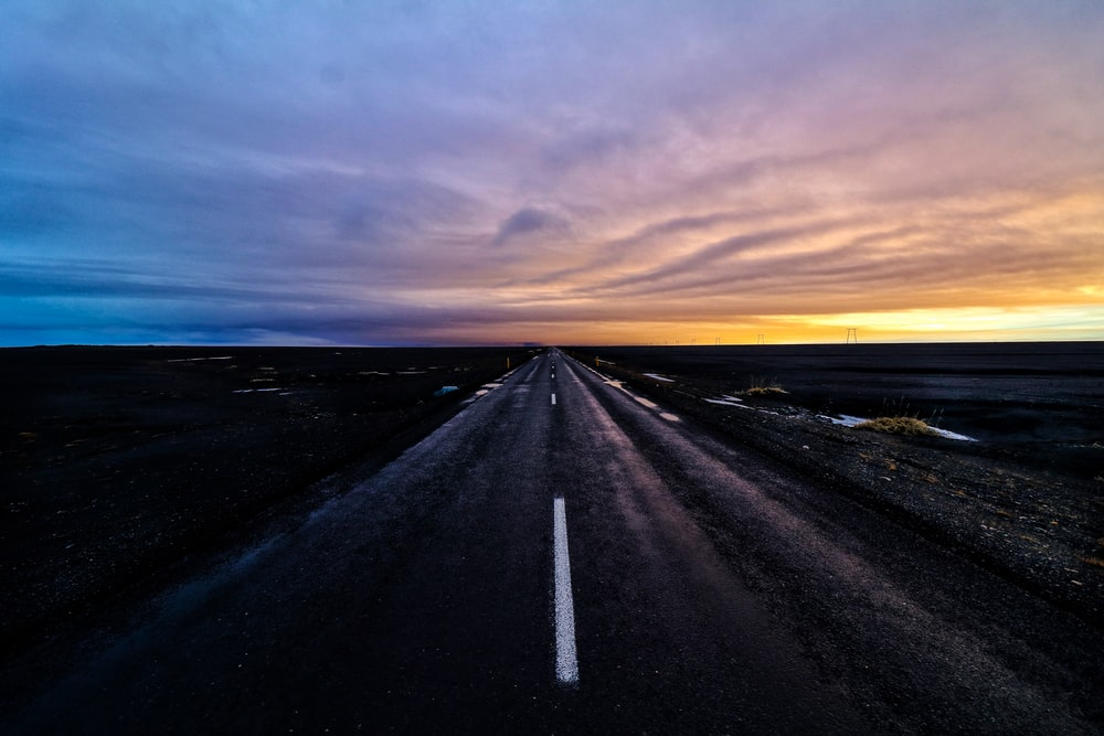 landscape photography of road during golden hour