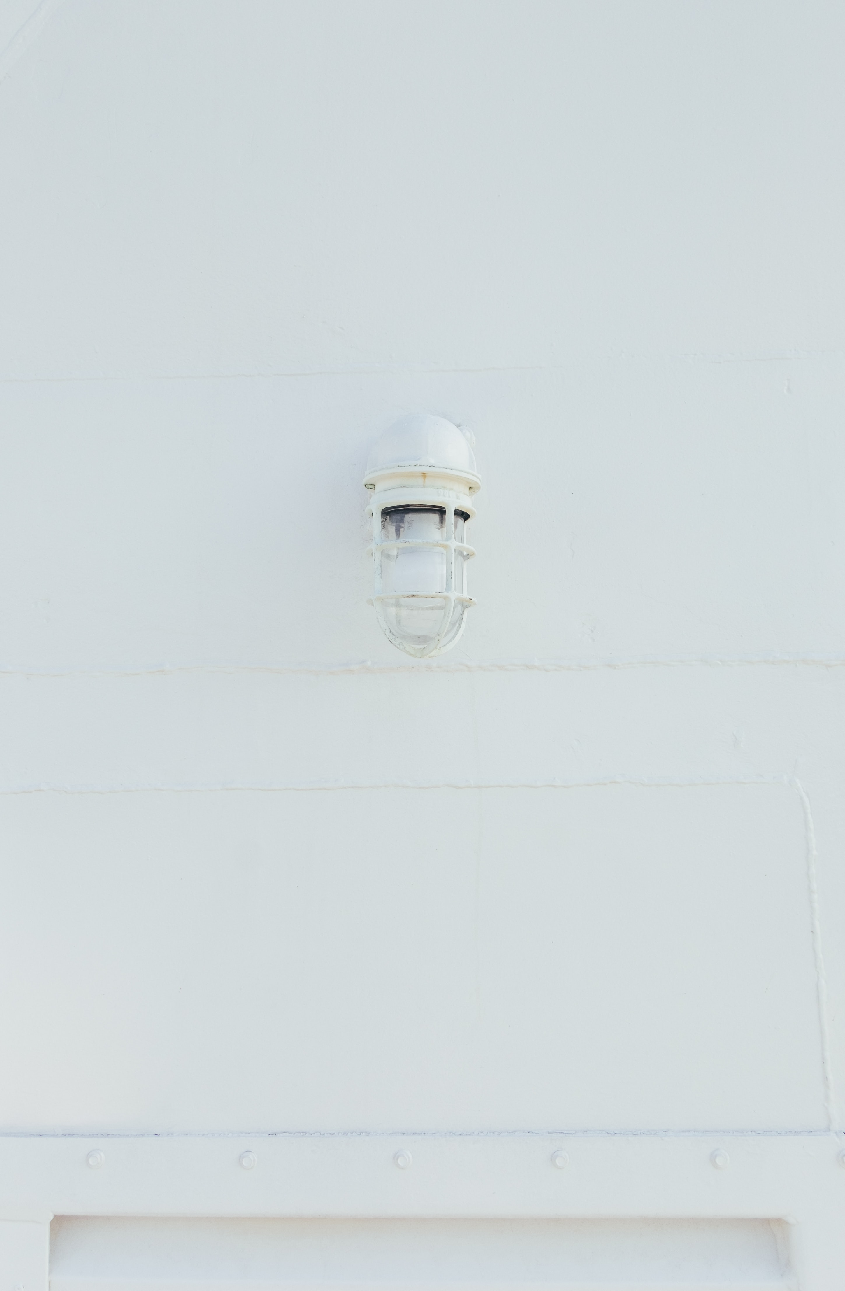 white lamp mounted on wall