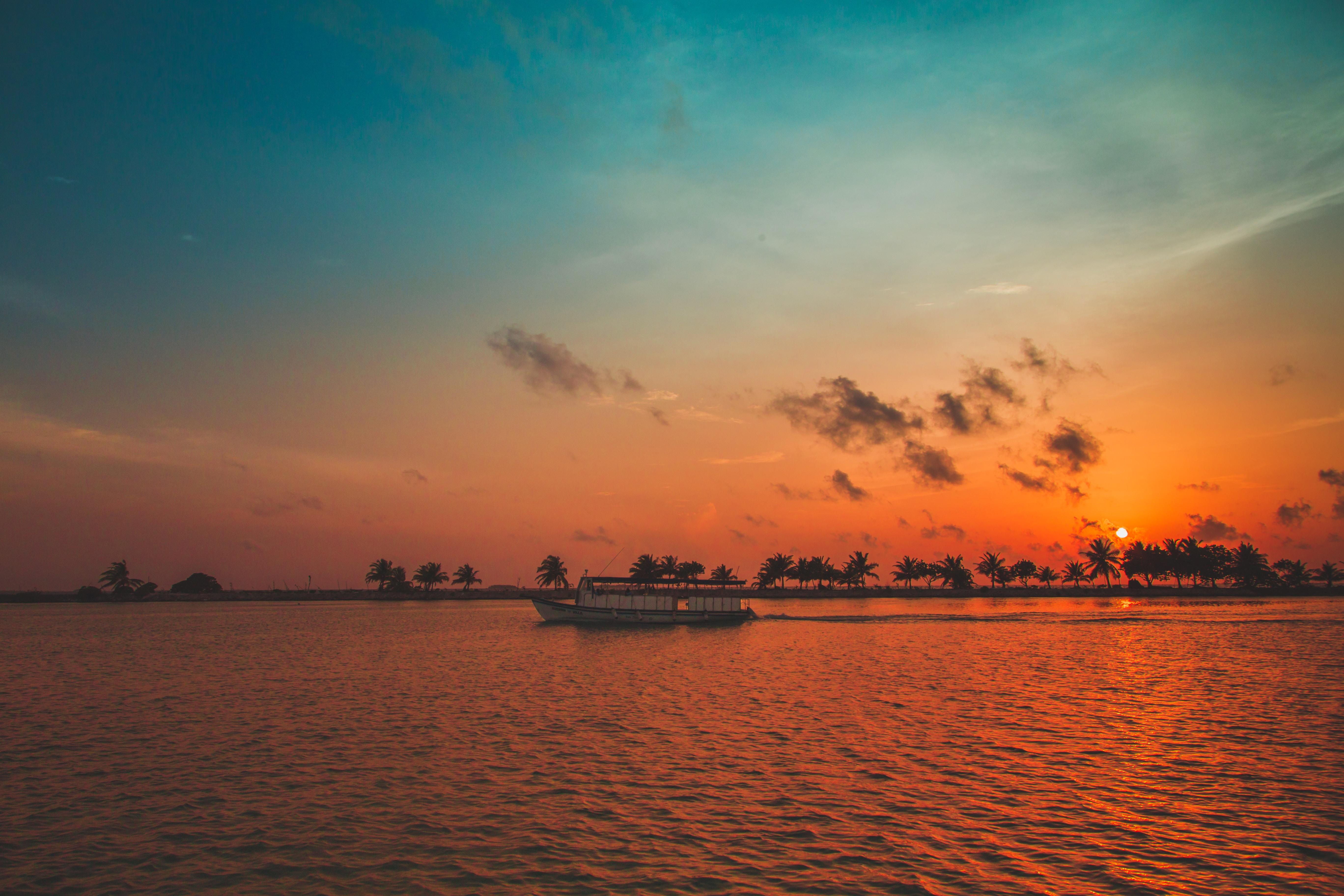 gray ocean water under sunset