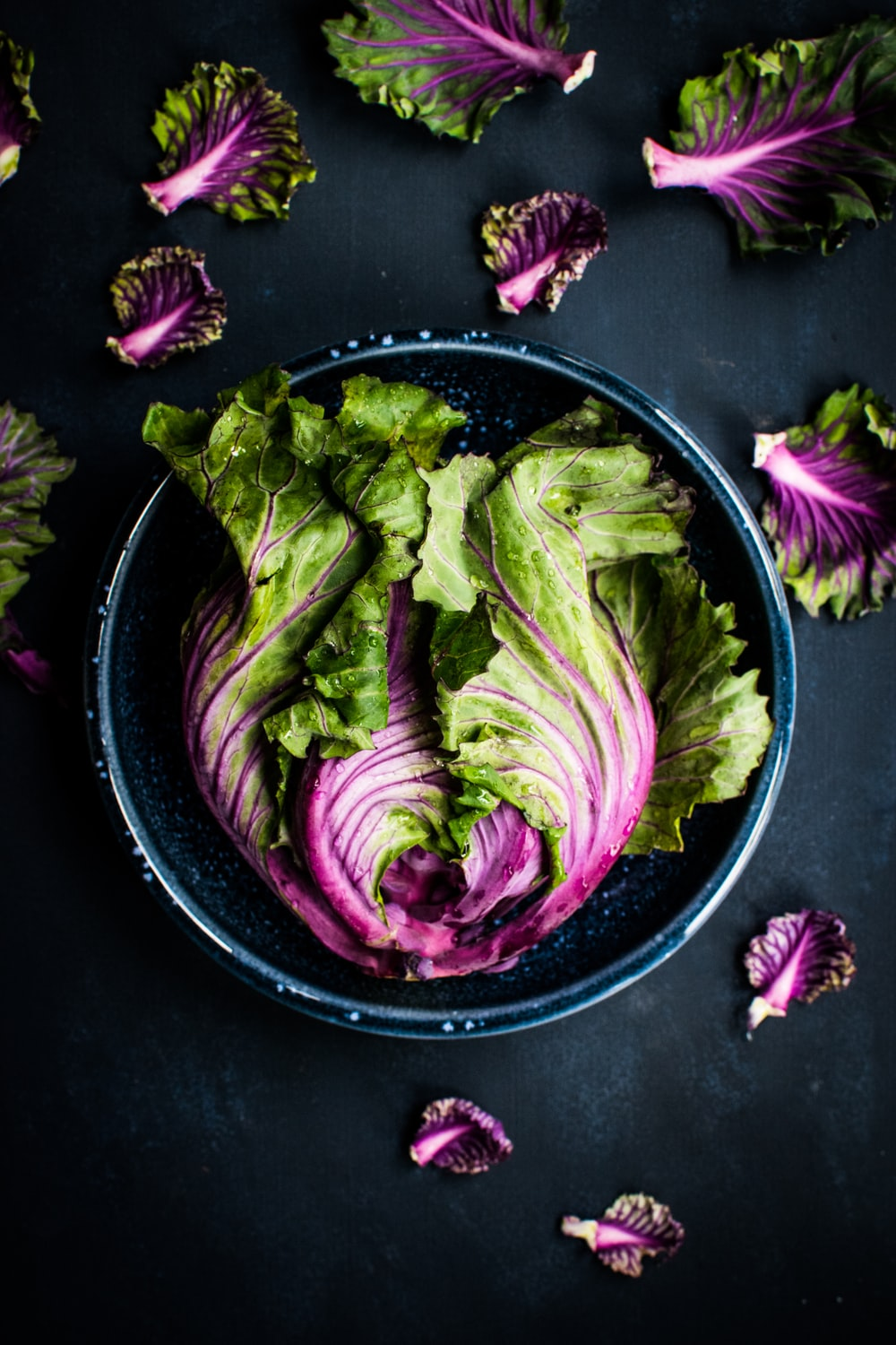 purple and green vegetable in black bowl
