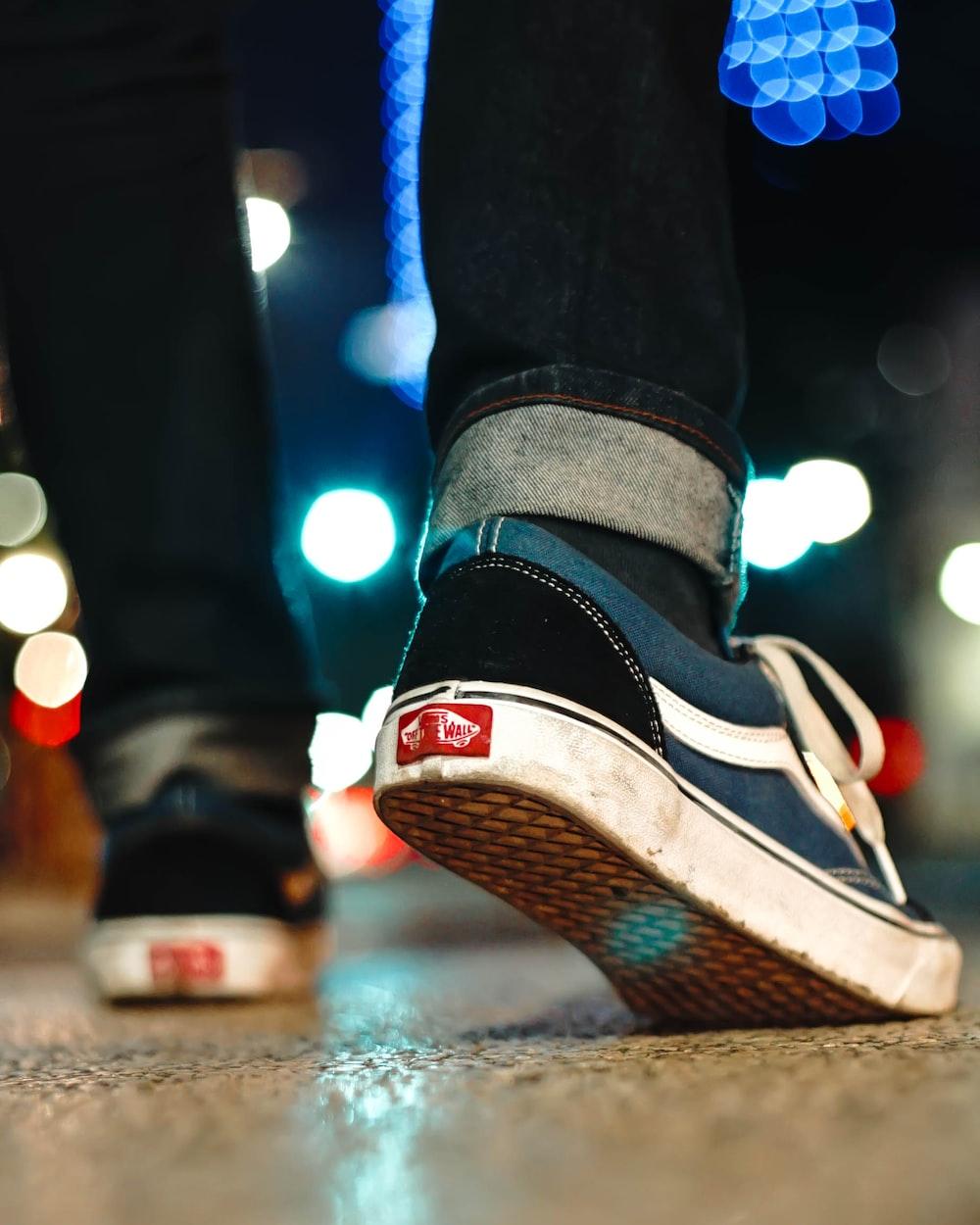 man walking on the road during nighttime