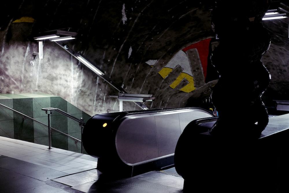 photograph of escalator beside stire