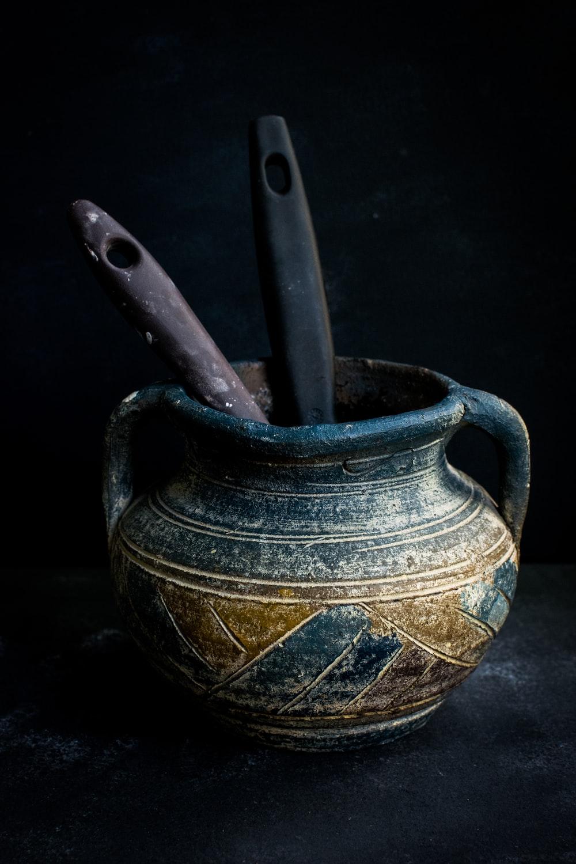 black and brown ceramic vase