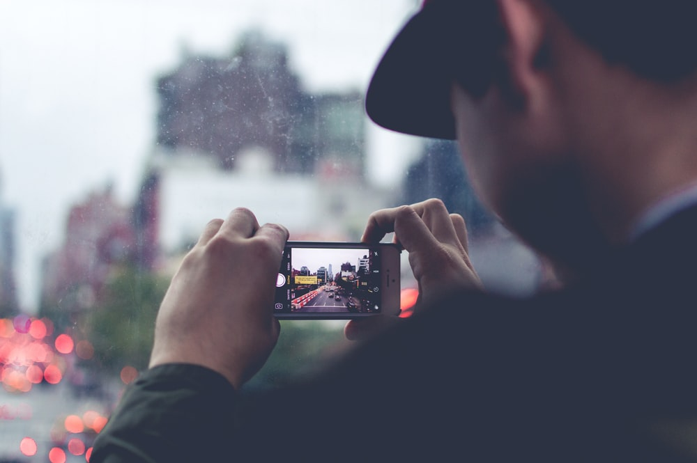 man using the smartphone camera