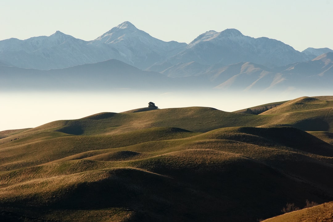 The view from the highest hill in the bottom of Pyramid Valley looking towards the mountains behind Lake Sumner, North Canterbury, New Zealand. This shot was taken in winter and the haze in the distance is mist that had formed along the Hurunui River.
