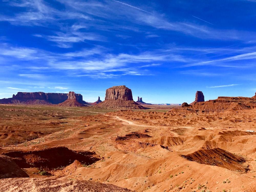 Orange sand and rock formations in a desert landscape