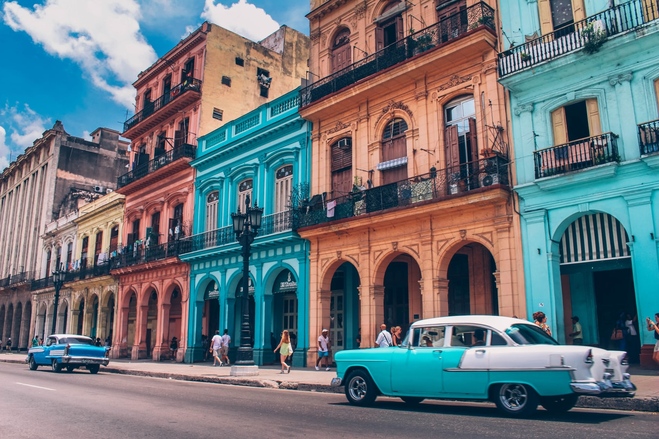 A colorful street with cars sitting out front in Havana, Cuba