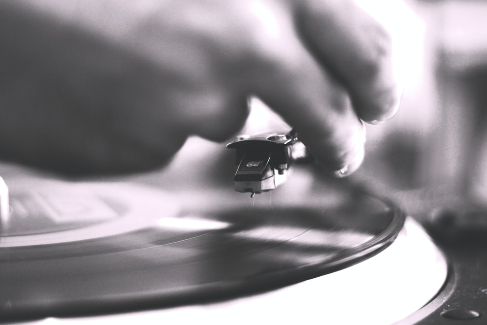 person playing vinyl record