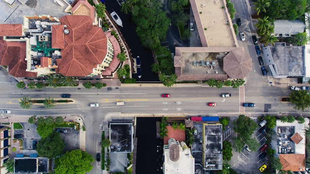 aerial photography of vehicles on road near concrete buildings