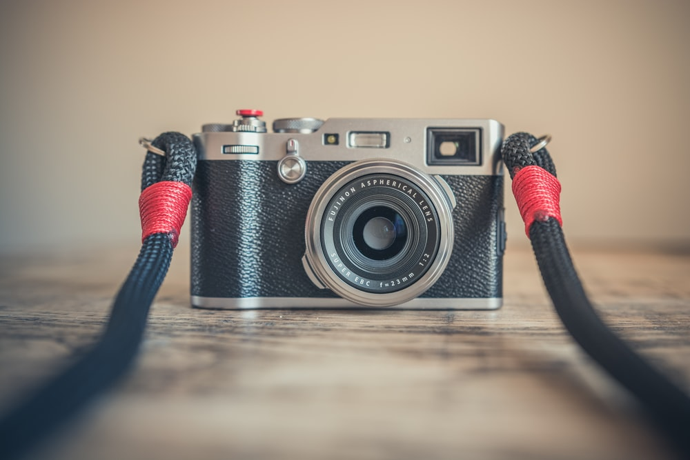 selective focus photography of black and gray bridge camera