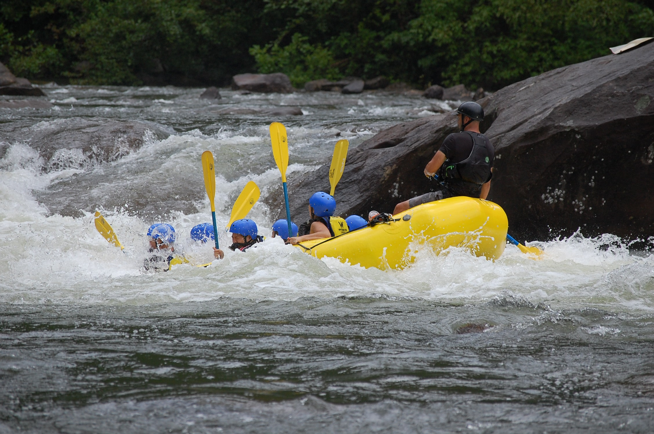 people riding on yellow kayak