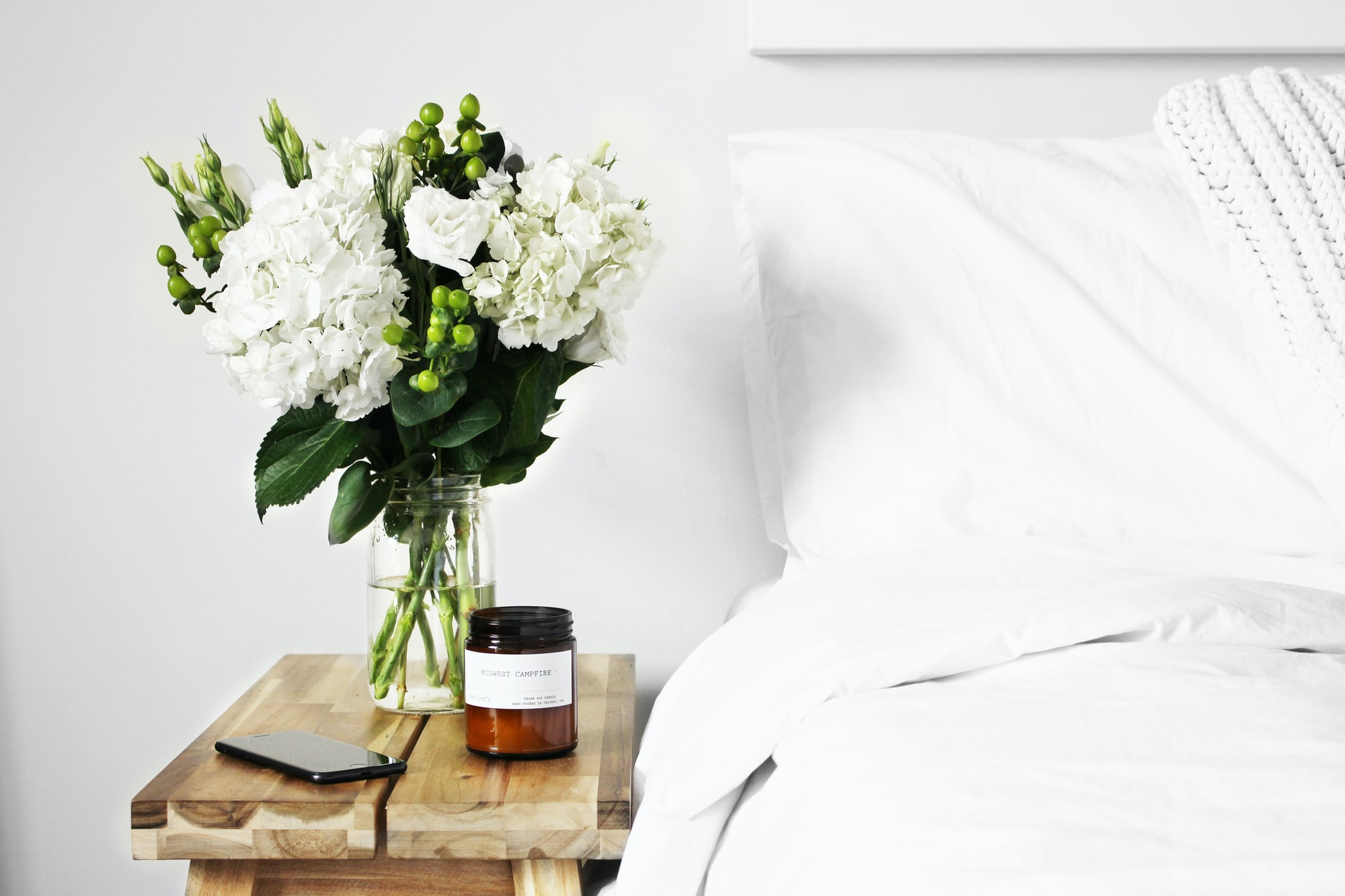 Is there anything better than all-white bedding? It makes me feel like I'm sleeping on a cloud. I made this fresh flower arrangement from flowers I bought at a local shop and had to take a photo.