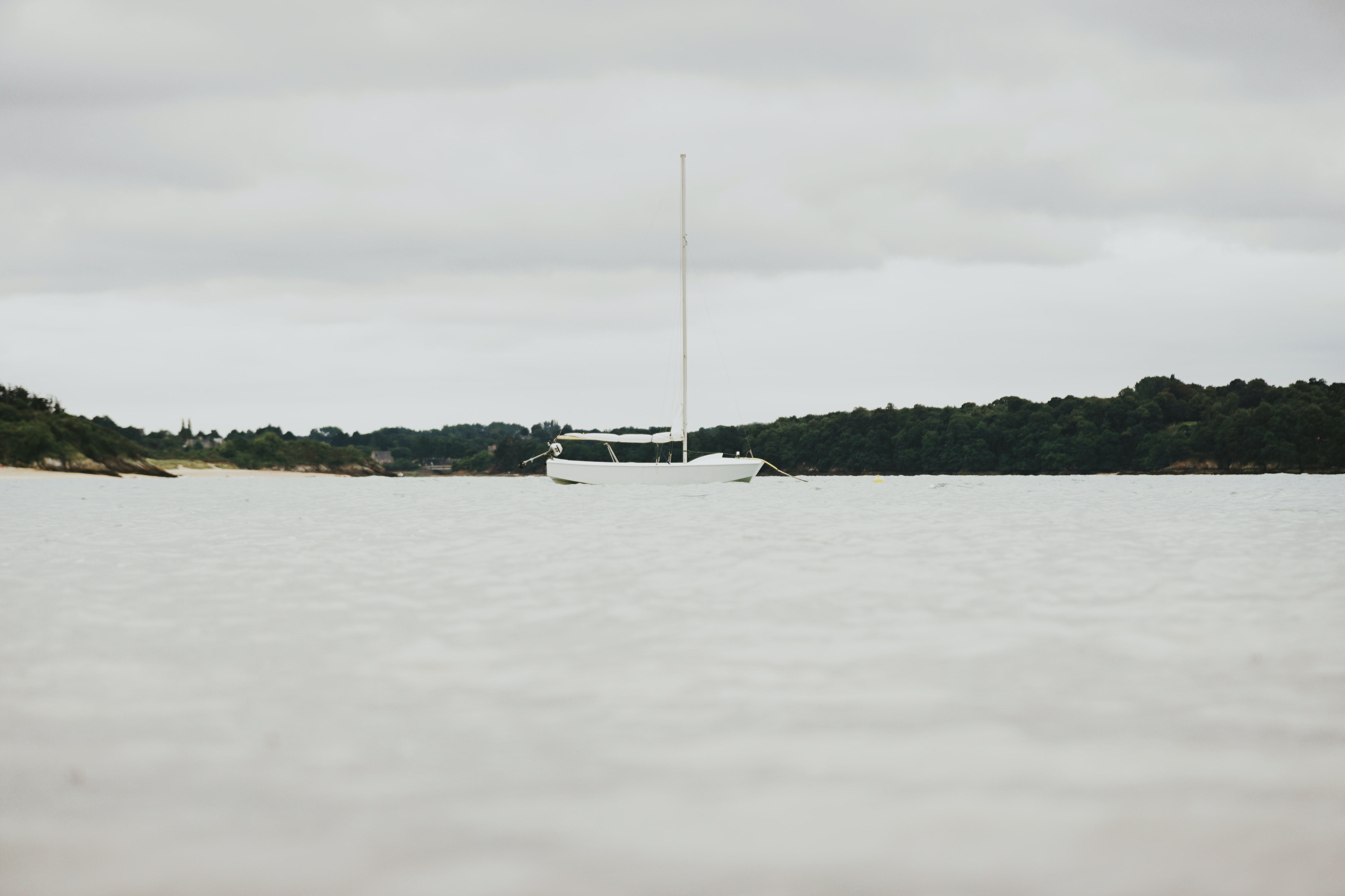white boat near island during daytime