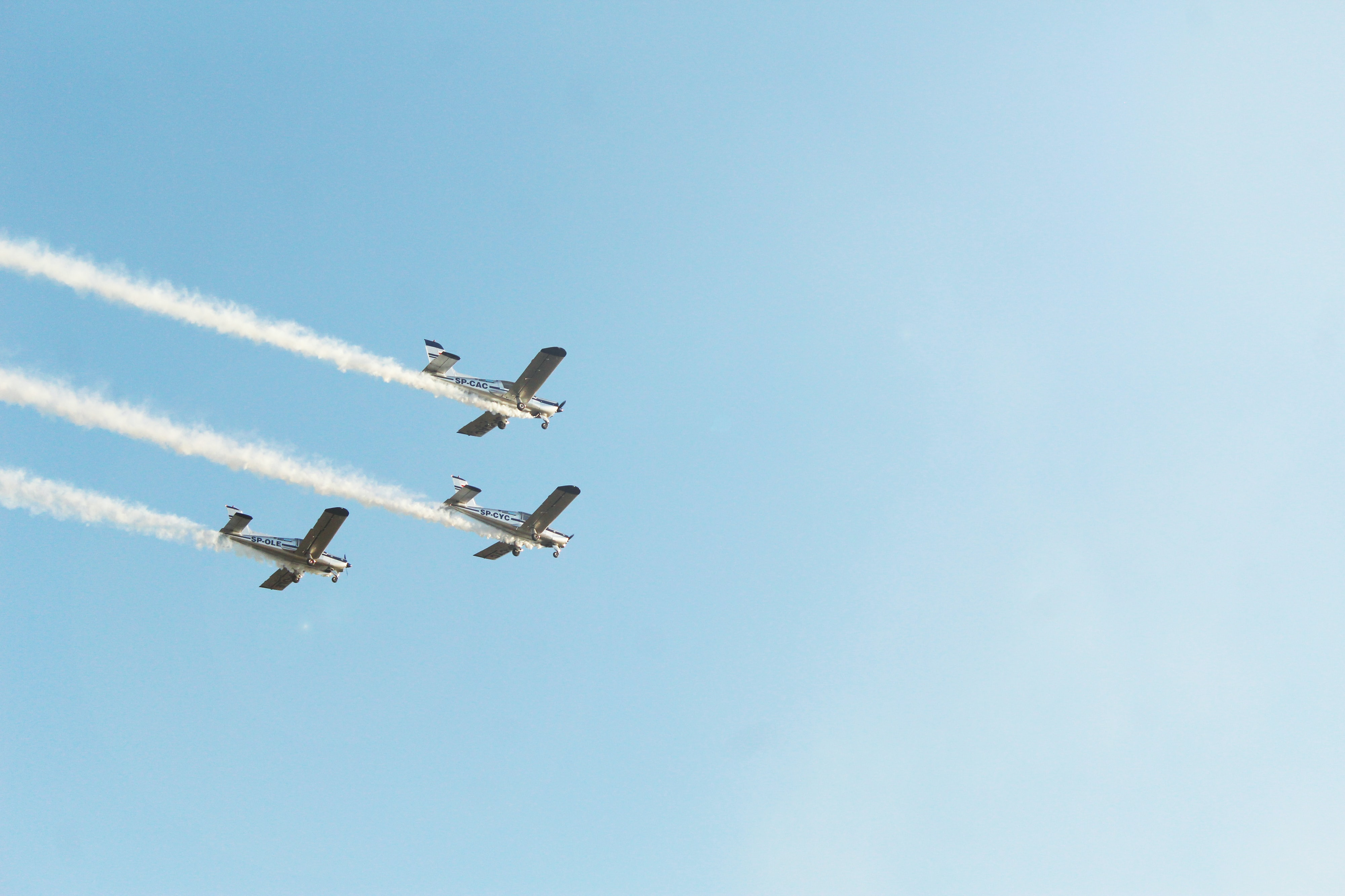 three gray jets flying during daytime