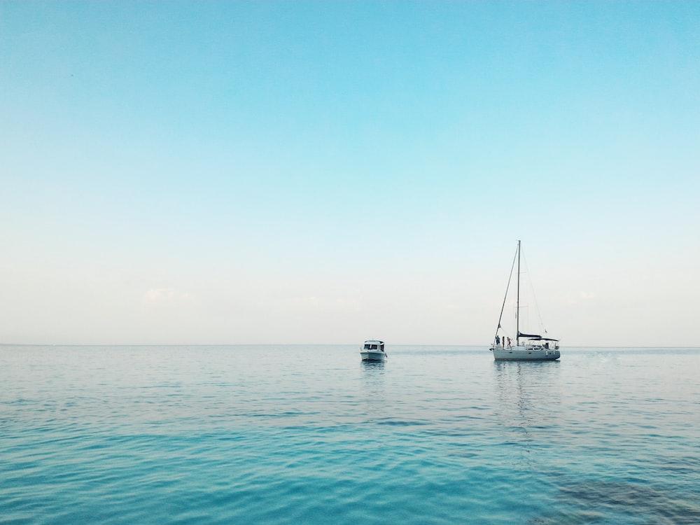 two boats docked on ocean
