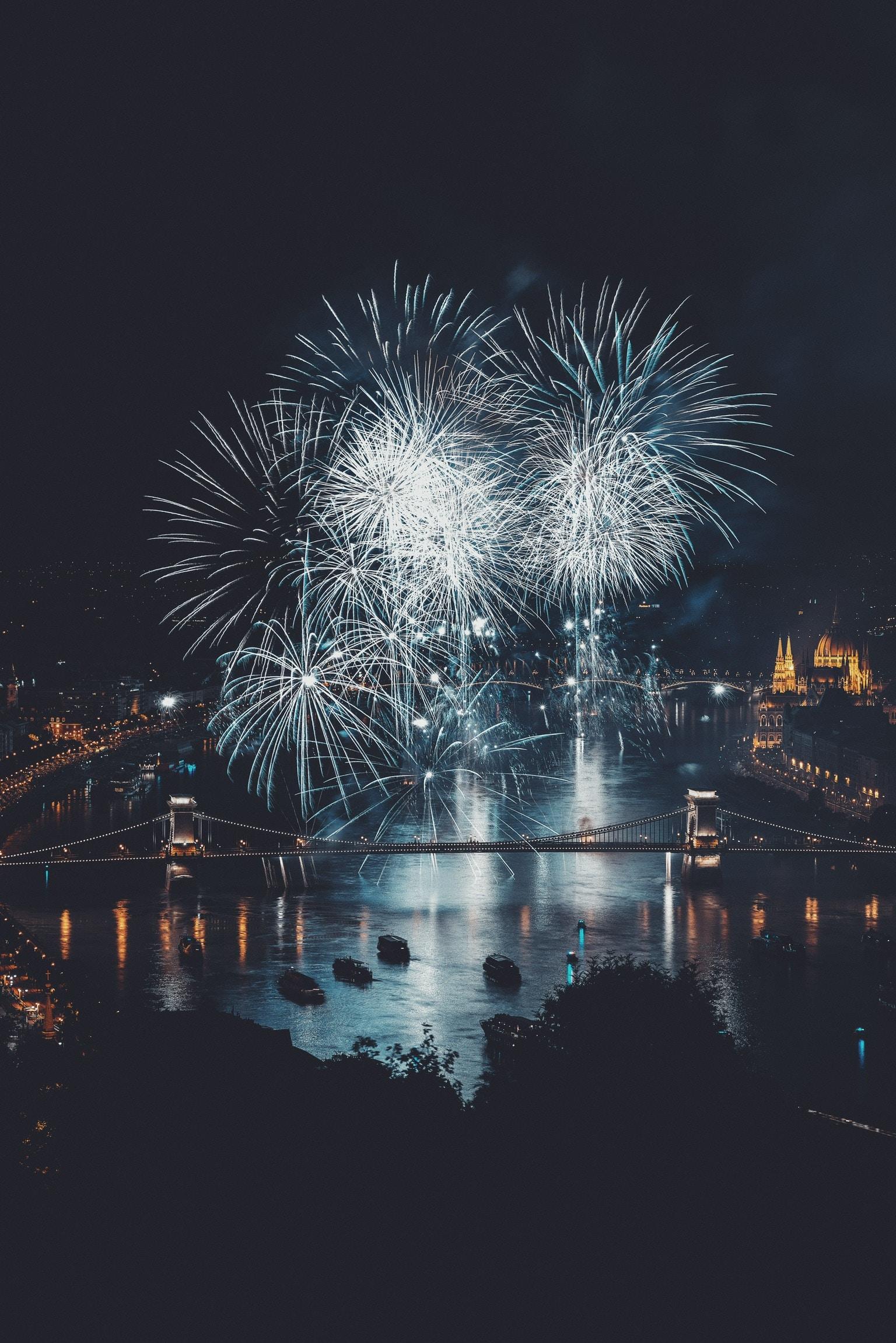 fireworks over bridge during nighttime