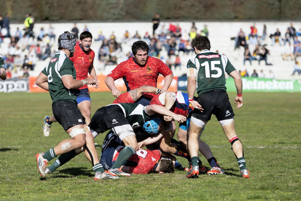 men playing rugby football