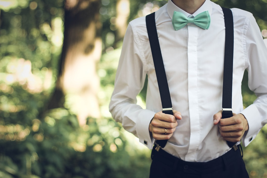 Wearing suspenders and bowtie