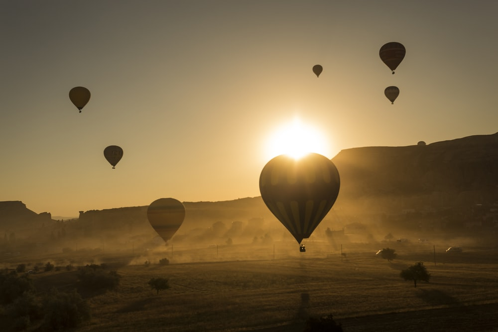 silhouette of hot air balloons in the sky