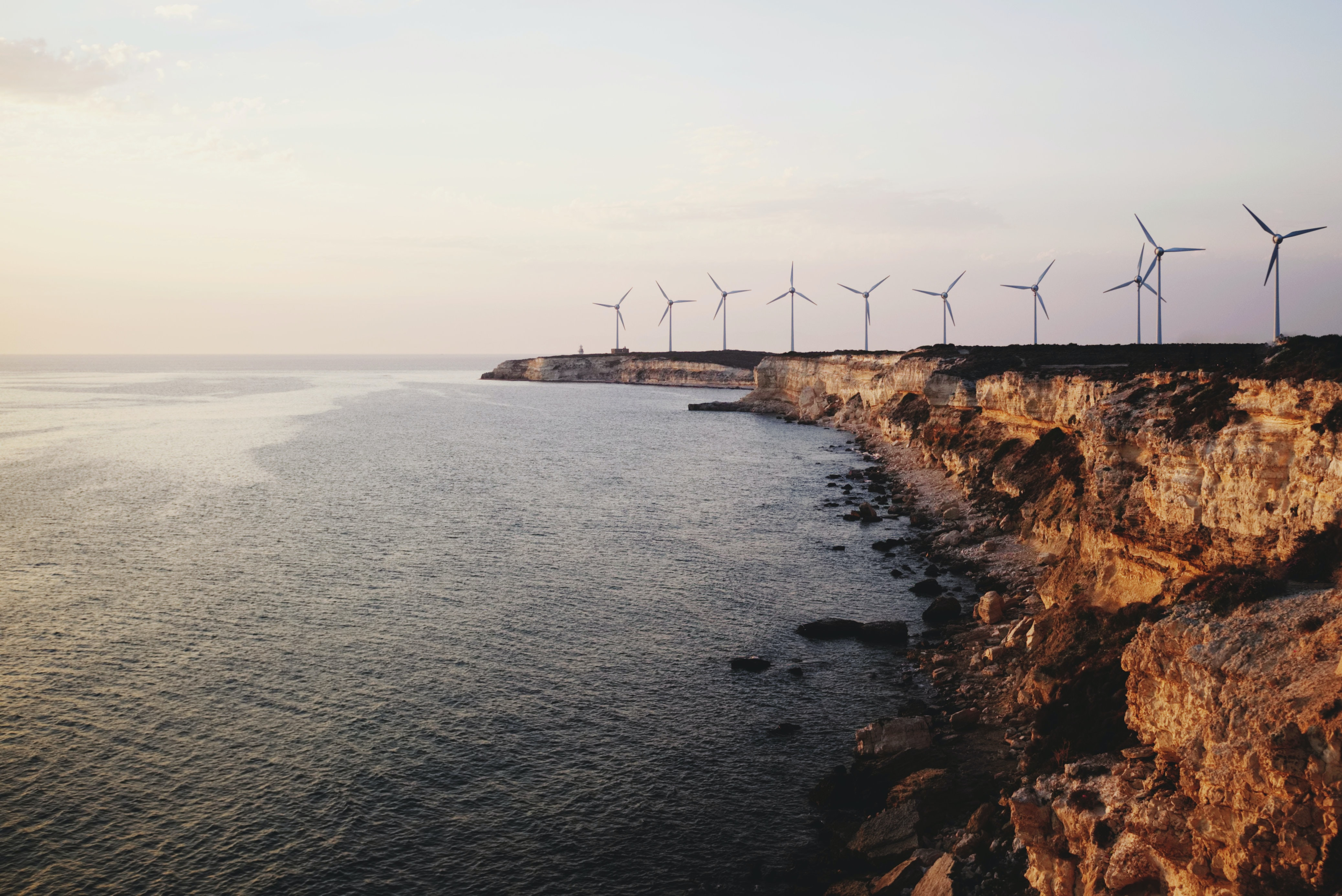 windmill near body of water during daytime